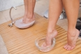 Customers cleansing their foot at nail salon